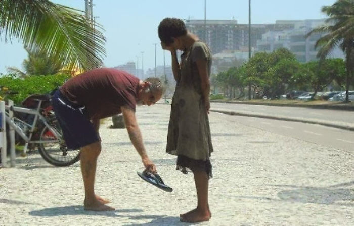 A Man Giving His Shoes To A Homeless Girl In Rio De Janeiro